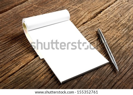 blank white notebook on the desk - stock photo