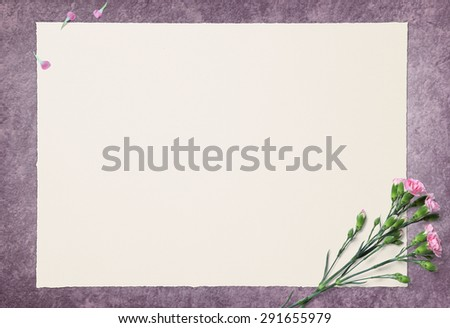 Blank White paper and Pink Carnation On Ragging Paint floor - stock photo