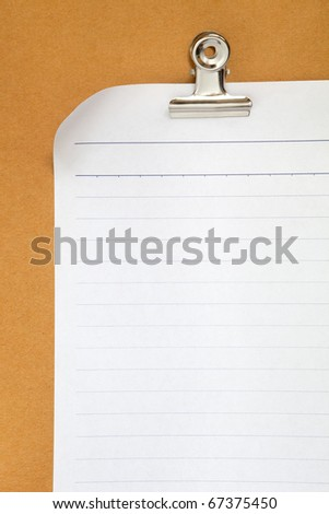 blank white paper on cardboard background with clip - stock photo