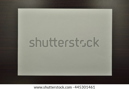 Blank White Paper on Wood Background With Shadow