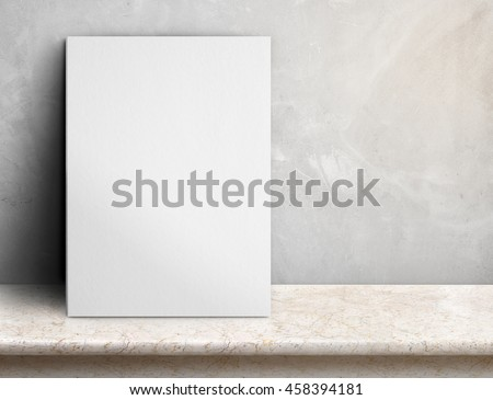 Blank White paper poster on cream marble table at grey concrete wall,Template mock up for adding your design and leave space beside frame for adding more text
