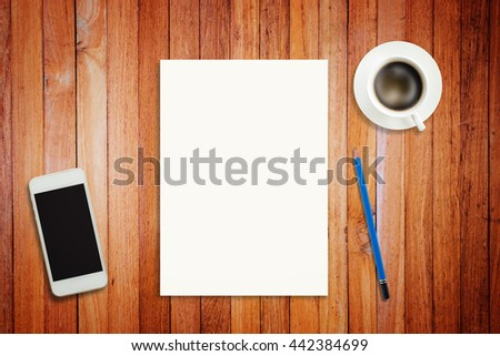 Blank white paper with object on wood table, hot coffee, pencil, smart phone. Business concept in make a plan, find idea, breaktime. Vignette effect with vintage filter, top view.