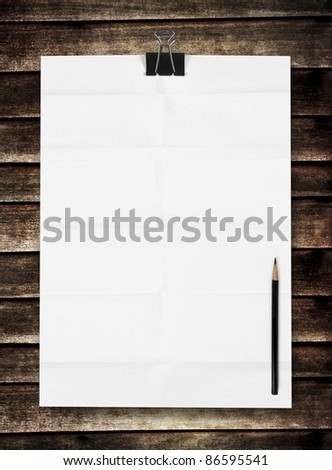 blank white paper with pencil on wooden background