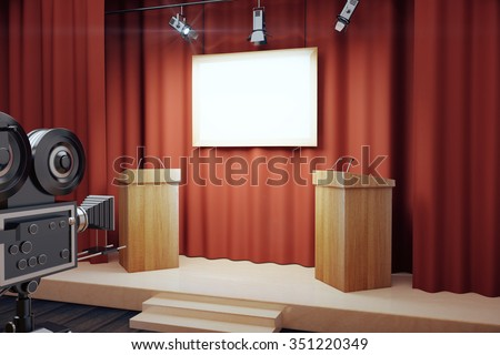 Blank white poster in conference hall with tribune and vintage camera, mock up - stock photo