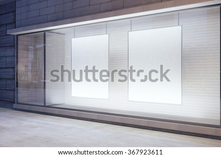 Blank white posters in the window on night empty city street, mock up 3D Render - stock photo