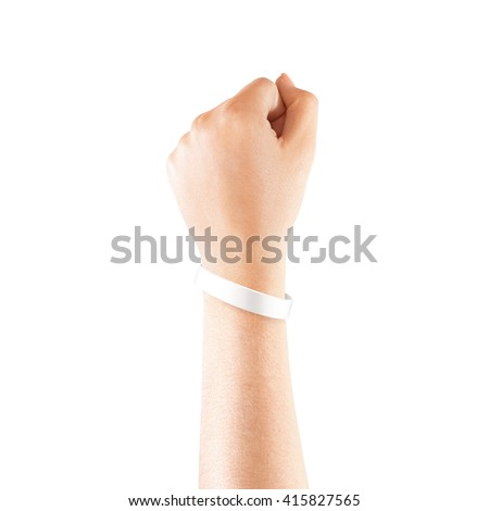 Blank white rubber wristband mockup on hand, isolated. Clear sweat band mock up design. Sport sweatband template wear on wrist arm.  Silicone fashion round social bracelet wear on hand. Unity band. - stock photo