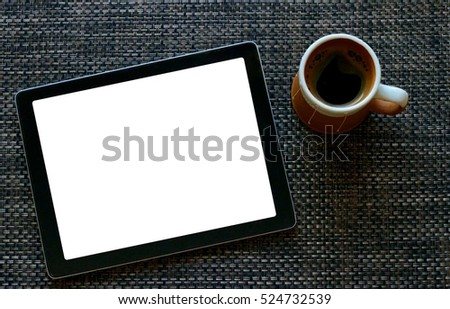 blank white screen tablet with coffee on the desk