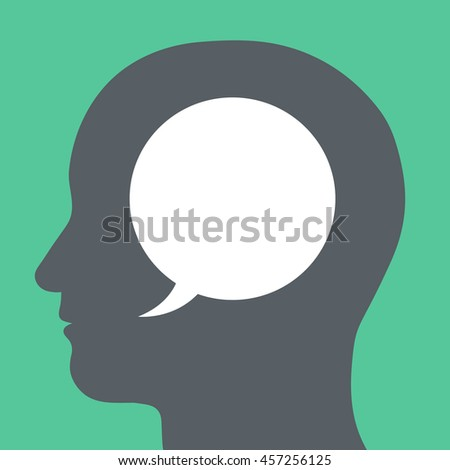 Blank white speech bubble with copy space for your text inside a human head silhouette in a conceptual illustration on a green background - stock photo
