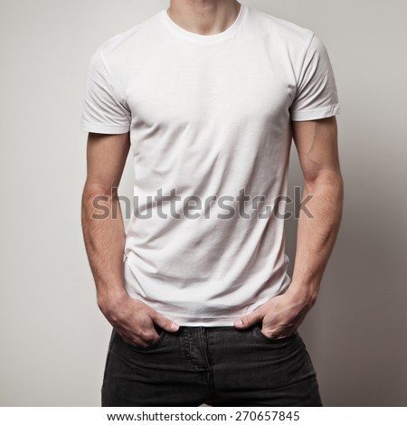 blank white t-shirt on muscle young man and white wall background - stock photo