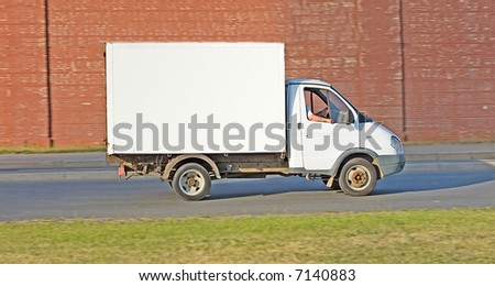 blank white truck on road - stock photo