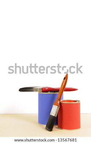Blank white wall with blue and red cans of paint and paint brushes.  Space for copy. - stock photo