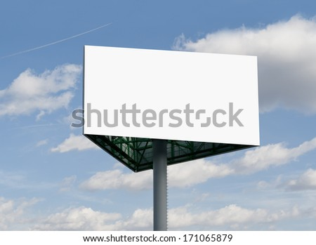Blank white 6x3 billboard against blue sky, put your own text here - stock photo