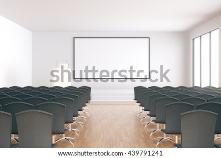 Blank whiteboard in conference hall interior with rows of seats, wooden floor and concrete walls. Mock up, 3D Rendering - stock photo