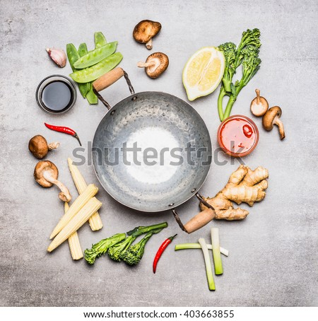 Blank Wok pan and ingredients for Chinese or Thai  cooking , top view. Asian cuisine  - stock photo