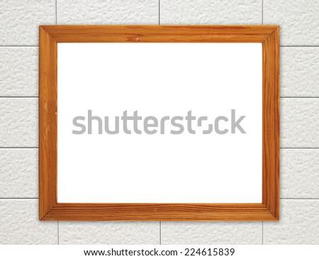 blank wood frame on brick stone wall background - stock photo