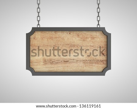 blank wood plate in metal frame on chains - stock photo