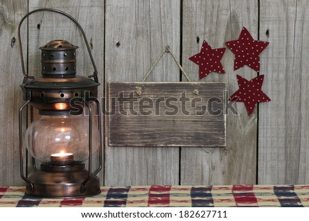 Blank wood sign by antique lantern and stars