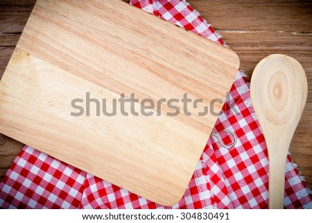 Blank wood Surface and wooden spoons, top view