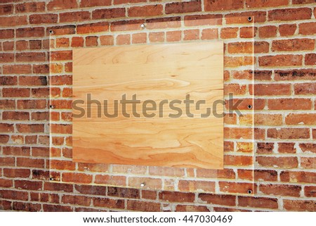 Blank wooden board under glass plate on red brick wall background. Mock up, 3D Rendering