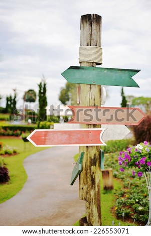 blank wooden direction signpost - stock photo