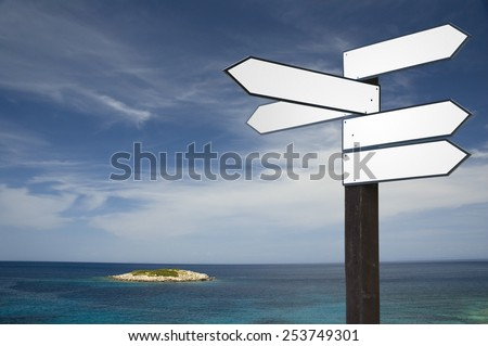 Blank wooden guidepost in vacation scenery - stock photo