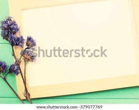 blank wooden photo frame and dried flowers valentines day with vintage filter color - stock photo