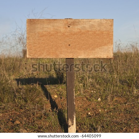 Blank wooden sign with post on white. - stock photo