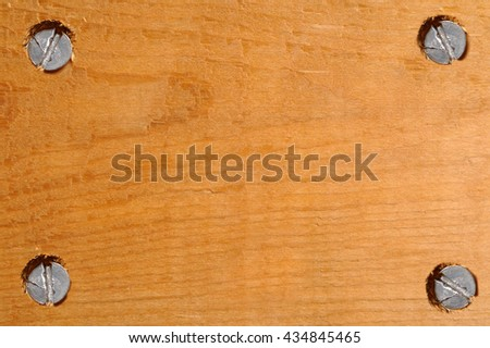 blank wooden signboard with four screws in corners