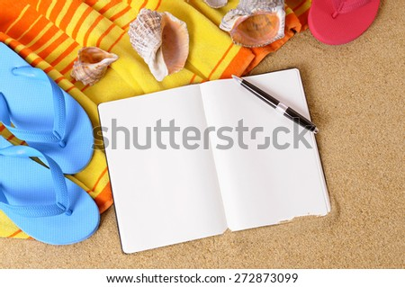 Blank writing book, pen, summer beach background, copy space. - stock photo