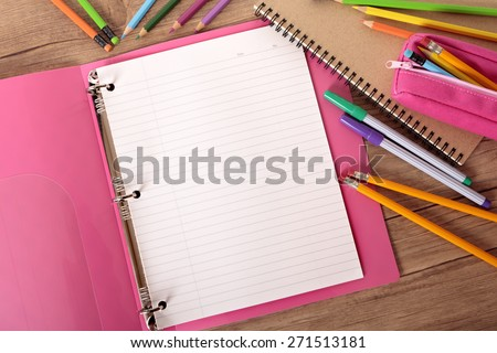 Blank writing book ring binder, student desk, top view - stock photo