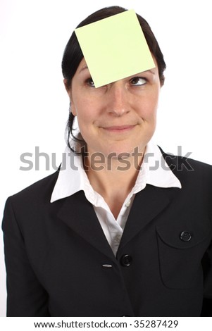 Blank yellow adhesive note on womans forehead as a reminder