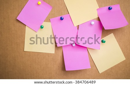 Blank Yellow paper posted on corrugated board  with tack pin for text and background - stock photo