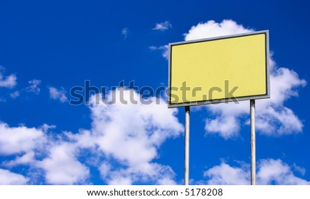 Blank yellow sign against deep blue sky background - stock photo