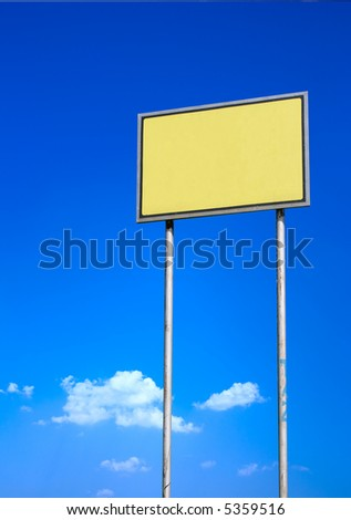 Blank yellow sign against deep blue sky background