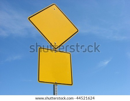 blank yellow sign with blue sky - stock photo