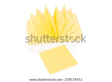Blank yellow sticky note and block with shadow and reflection on white - stock photo