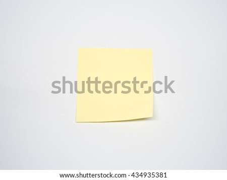 blank yellow sticky note on white background with soft shadow