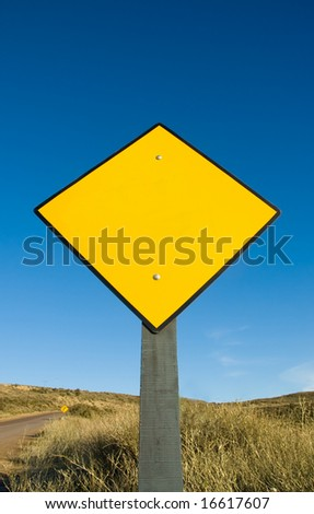 Blank yellow traffic sign in a road in Patagonia. - stock photo