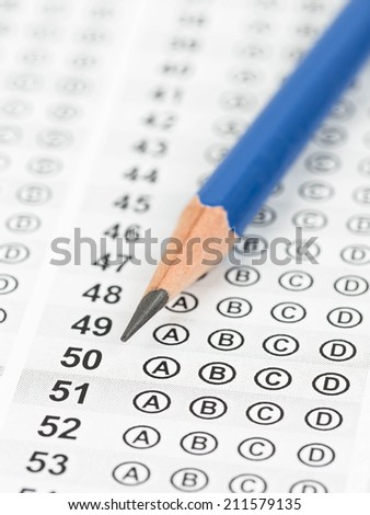 Blanked answer sheet focus on pencil - stock photo