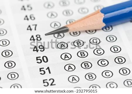 Blanked answer sheet with pencil close-up - stock photo