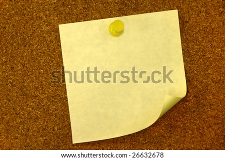 Blanked note on a bulletin board with pushpin - stock photo
