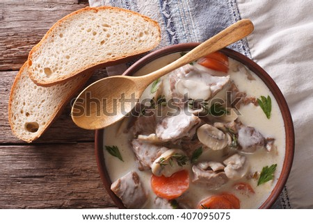 Blanquette of veal in a creamy sauce in a bowl on the table. Horizontal view from above - stock photo