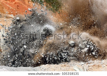 Blast in open cast mining quarry - stock photo