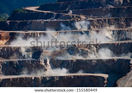 Blast in open  quarry  - stock photo