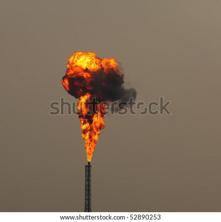Blast of fire from oil refinery stack