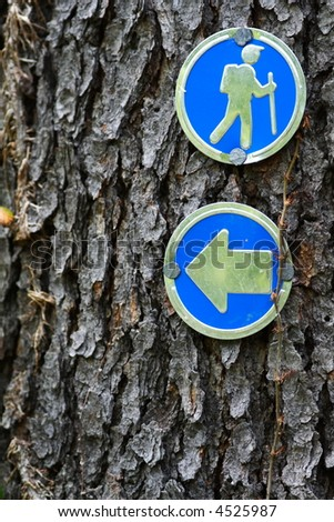 Blazes (small signs) on hiking trail - stock photo