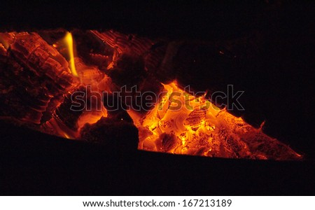 Blazing fire in a wood burning stove - stock photo