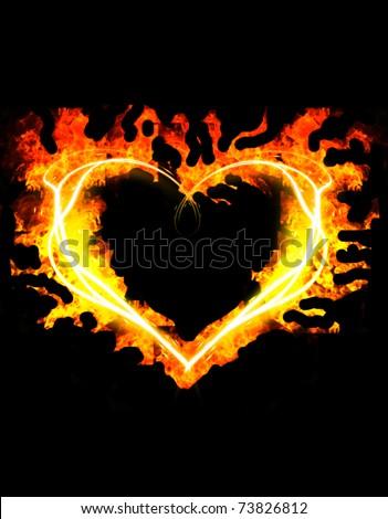 blazing heart  on the black background - stock photo
