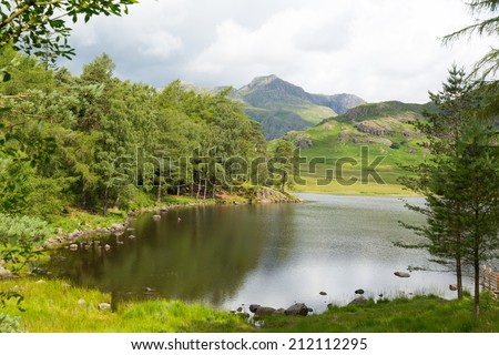Blea Tarn and Langdale Pikes between Great Langdale and Little Langdale Lake District Cumbria England UK - stock photo