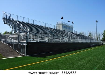 Bleachers of American High School Football Stadium - stock photo